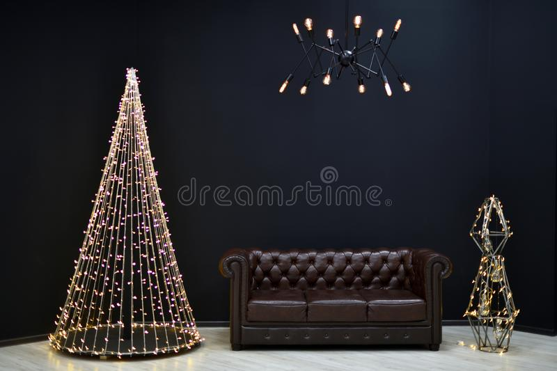 New year& x27;s Loft-style decor against a black wall, a Christmas tr royalty free stock images