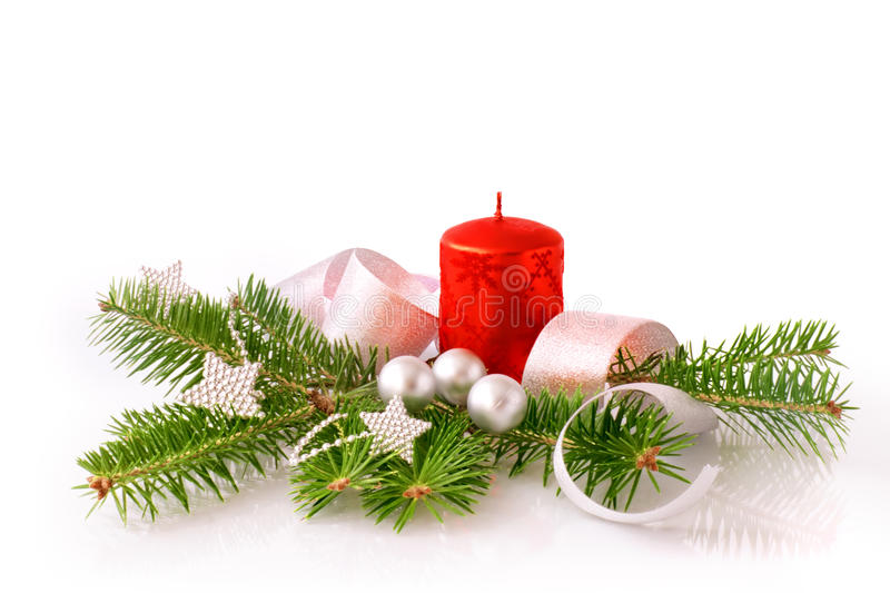 Composition from a fur-tree branch, a candle and New Year's toys royalty free stock photo