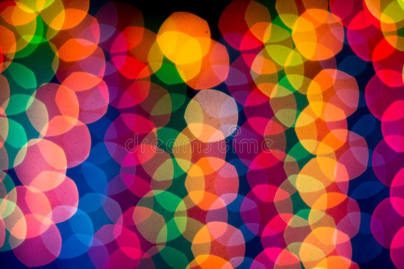 New Year`s rainbow bokeh. Holiday rainbow christmas lights bokeh background. stock images