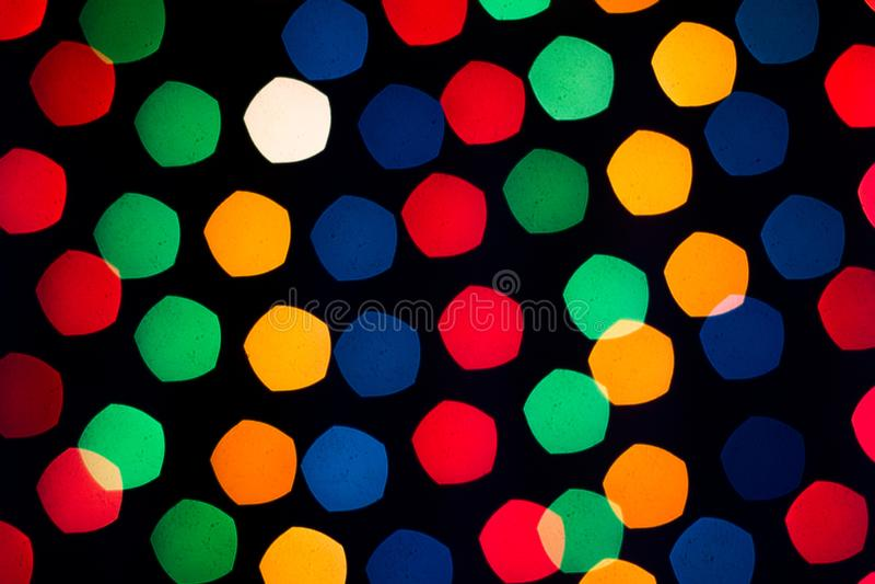 New Year`s rainbow bokeh. Holiday rainbow christmas lights bokeh background. stock photos