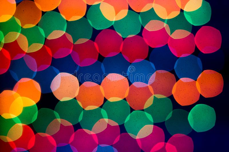 New Year`s rainbow bokeh. Holiday rainbow christmas lights bokeh background. stock photo