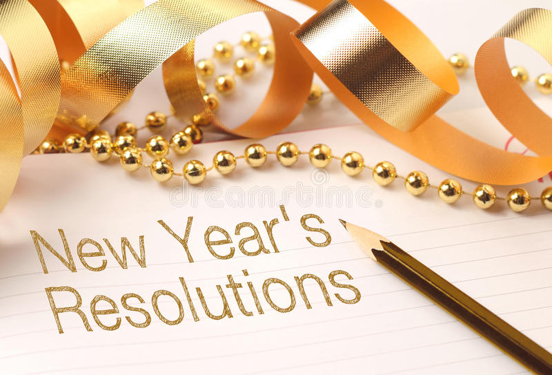 New year's resolutions. With gold color decorations. New Year's resolutions are goals or promises that people make for the New Year to make their royalty free stock photos