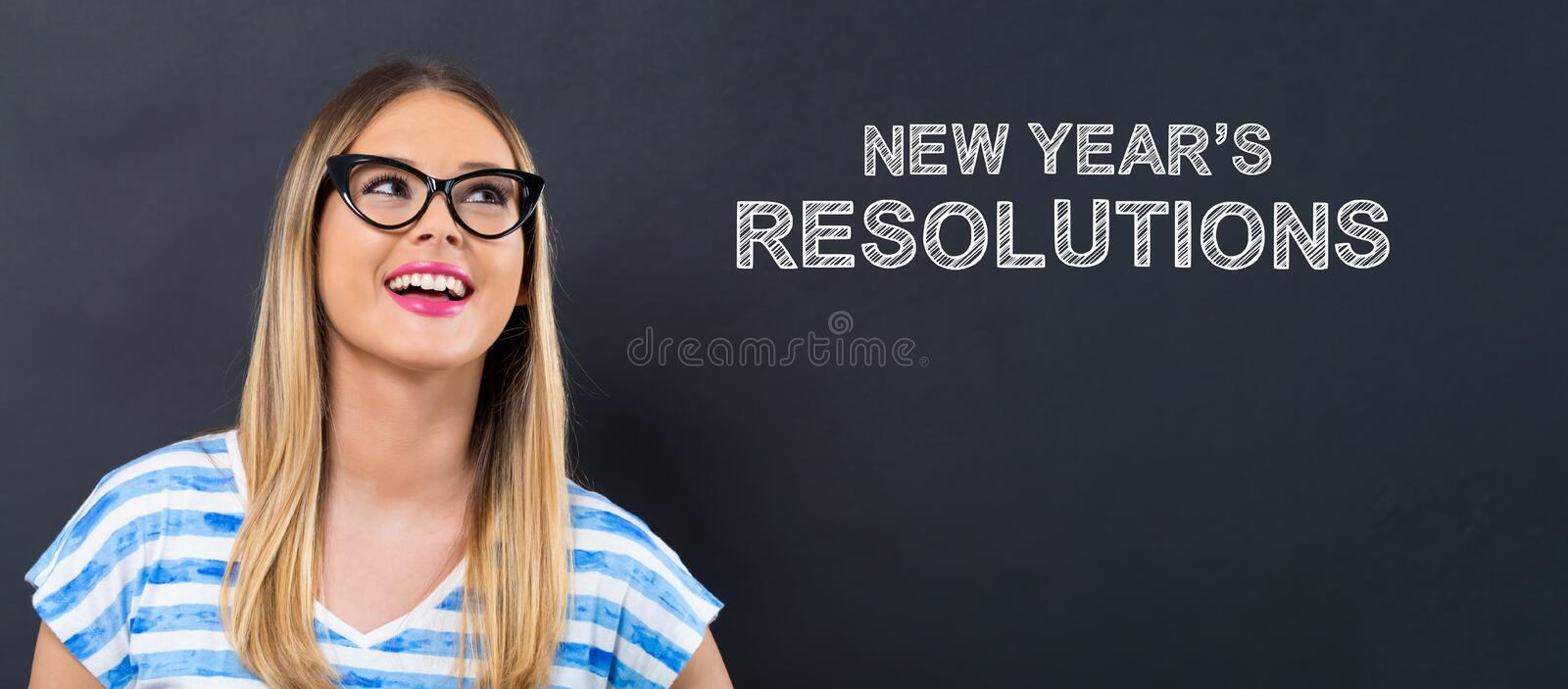 New Year`s Resolutions with happy young woman royalty free stock photo