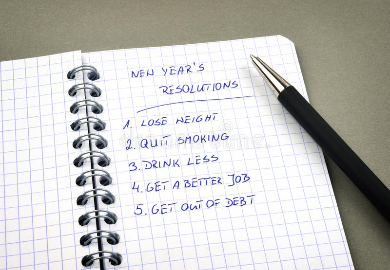 New Year's resolutions listed. In notepad stock photos