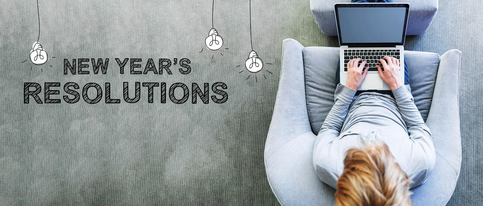 New Year`s Resolutions with man using a laptop stock photos