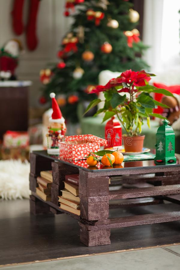 New Year`s room, christmas table with presents royalty free stock photography