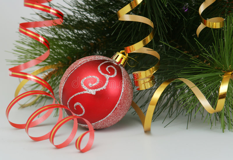 The New Year's sphere and fur-tree branch are on a royalty free stock photography