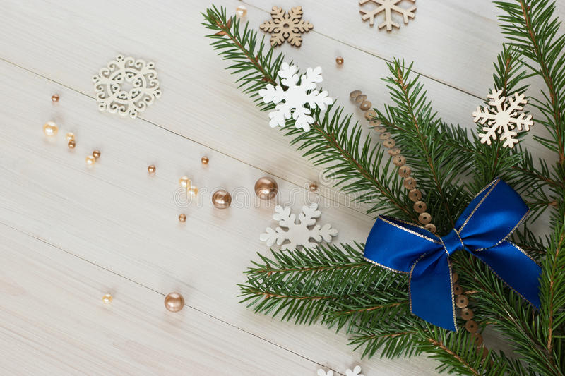 New Year`s still life with branches of a Christmas tree and a bow. royalty free stock images