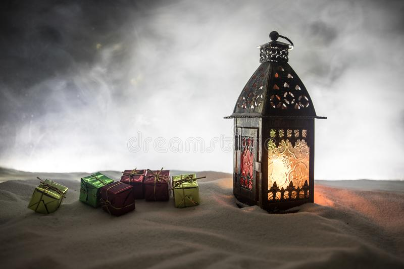 New Year's still-life postcard red lamp candle wax-boxes gift-box Christmas tree light bulbs lights wooden background snow stock photos