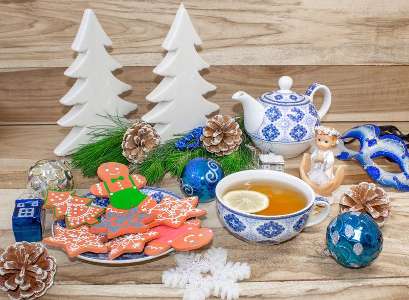 New Year`s table with spruce branches and decorations. Christmas tea with cookies, gingerbread, small stars. Festive background stock photo