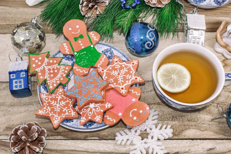 New Year`s table with spruce branches and decorations. Christmas tea with cookies, gingerbread, small stars. Festive background stock images