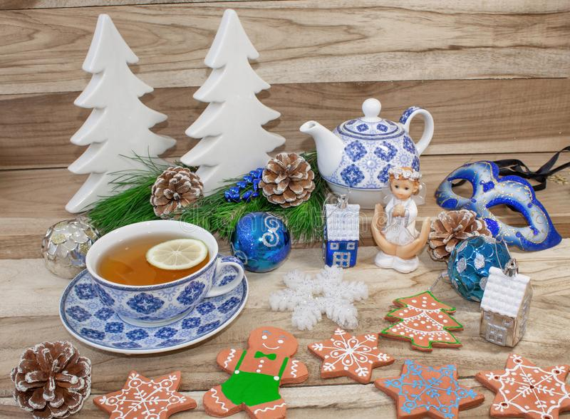 New Year`s table with spruce branches and decorations. Christmas tea with cookies, gingerbread, small stars. Festive background royalty free stock photo