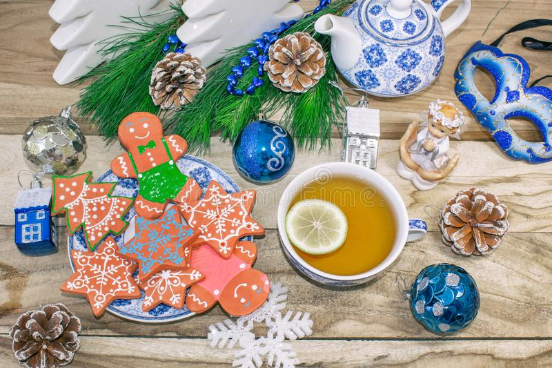 New Year`s table with spruce branches and decorations. Christmas tea with cookies, gingerbread, small stars. Festive background royalty free stock photos