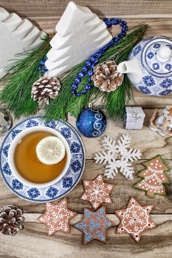 New Year`s table with spruce branches and decorations. Christmas tea with cookies, gingerbread, small stars. Festive background royalty free stock photography