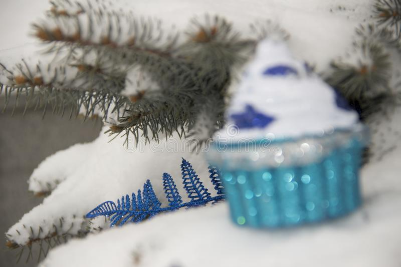 New Year`s toy on a Christmas tree with snow. royalty free stock image