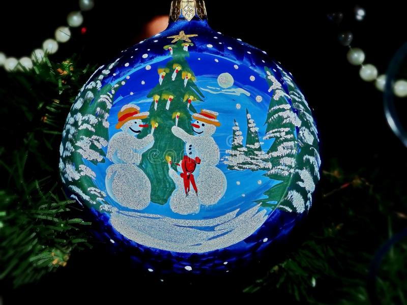 New Year`s toys on branches of a fur-tree. Glass sphere, beads. Hand-painted, creativity. Celebratory background. stock photo