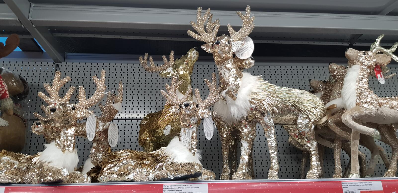 New Year`s toys on the supermarket shelf - snowmen, deer, bears. Russia Moscow. 10,11,2018 New Year`s toys on the supermarket shelf - snowmen, deer, bears royalty free stock photos