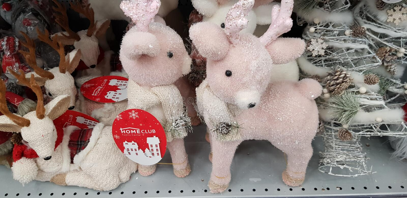 New Year`s toys on the supermarket shelf - snowmen, deer, bears. Russia Moscow. 10,11,2018 New Year`s toys on the supermarket shelf - snowmen, deer, bears royalty free stock photography
