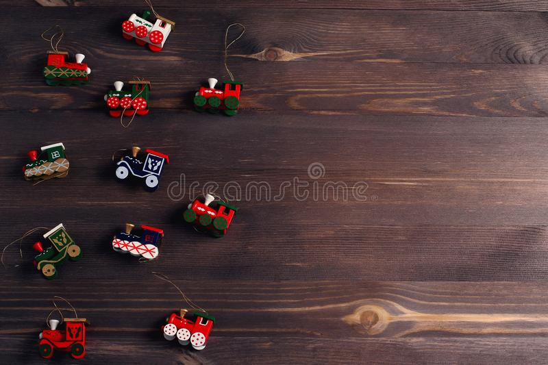 New Year`s toys on a wooden background. Blank space for a text. Creative layout. Flat lay, top view royalty free stock photography