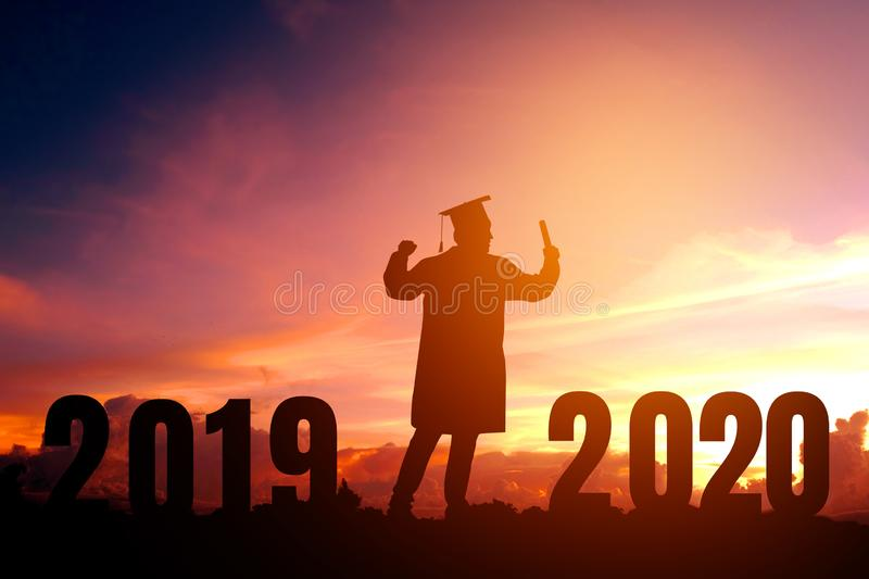 2020 New year Silhouette young man graduation in 2020 years education congratulation concept ,Freedom and Happy new year royalty free stock photography