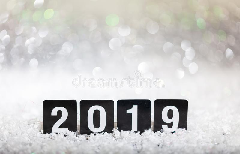2019, new year on snow, abstract bokeh lights background stock photography