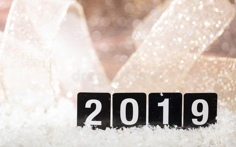 2019, new year on snow, abstract bokeh lights background royalty free stock photo