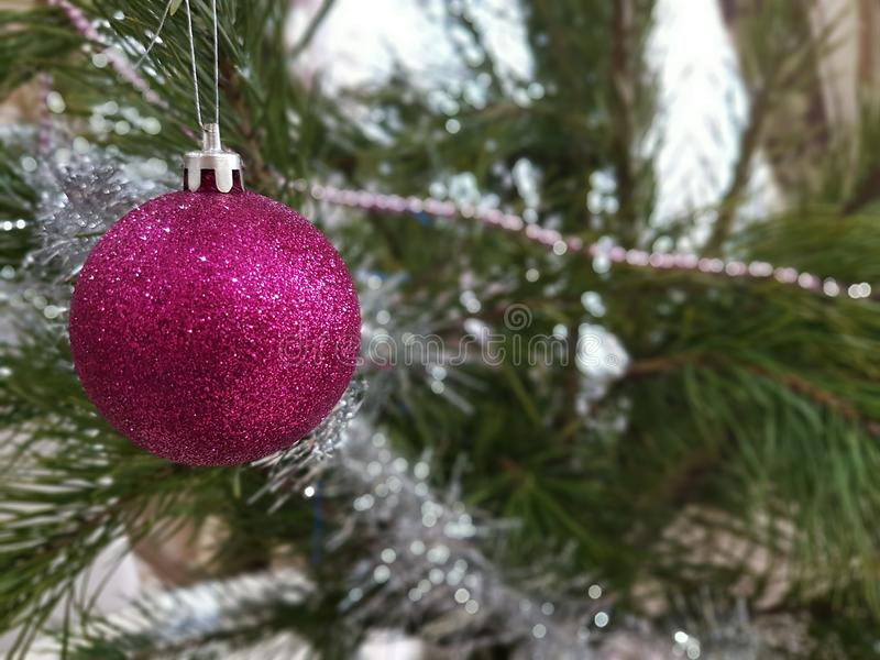New Year`s toy on the Christmas tree star, background royalty free stock photos