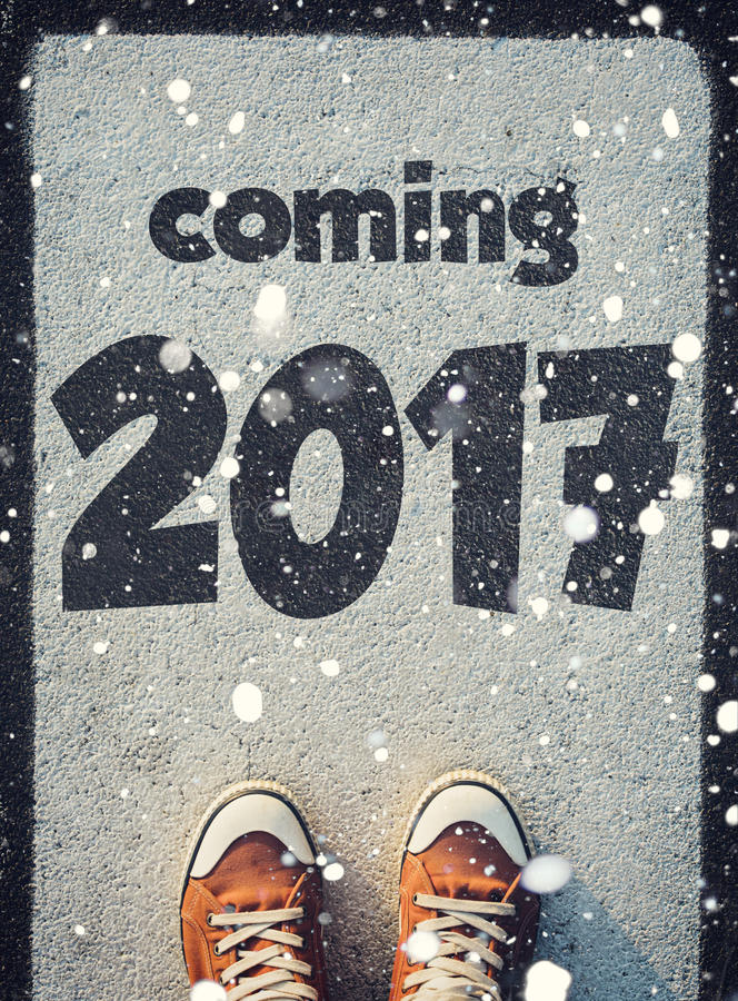 New Year 2017. Student standing above the sign 2017,New Year concept stock photography
