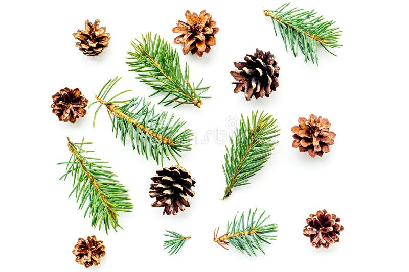 New year symbols pattern. Spruce branches and cones on white background top view.  royalty free stock images