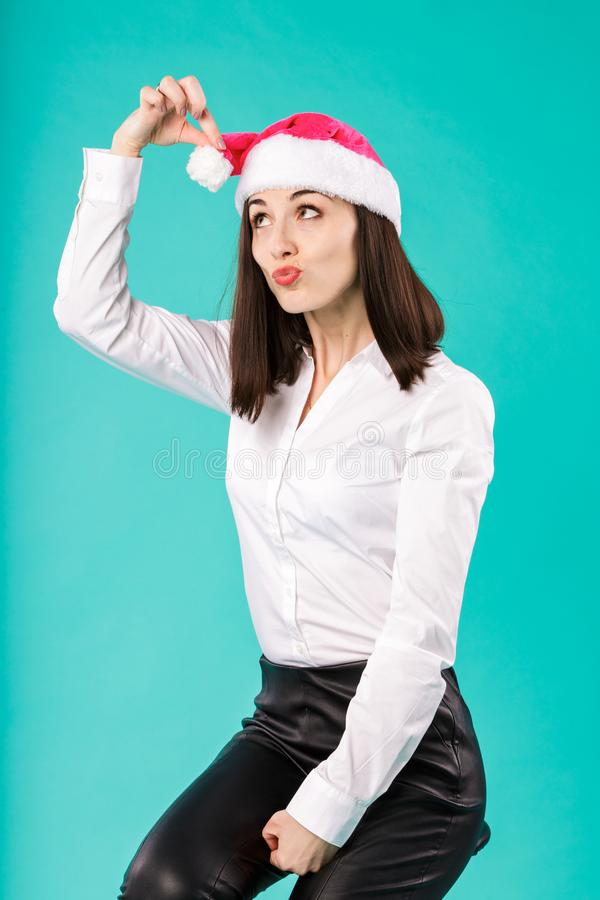 New Year theme Christmas winter holidays office of company employees. portrait young caucasian woman businessman white shirt in stock photo