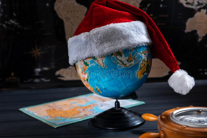 New year travel concept. Globe with santa claus hat royalty free stock photography