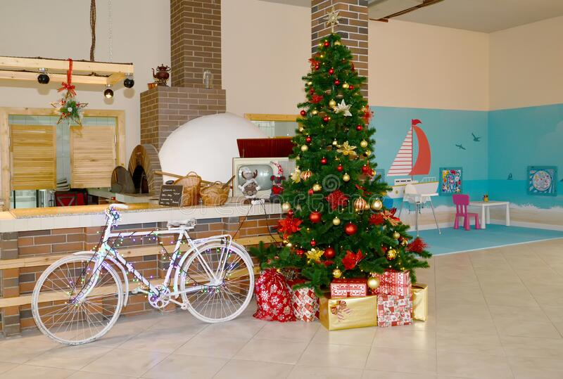 New Year tree and a bicycle near the bar. Interior of a modern cafe.  stock images