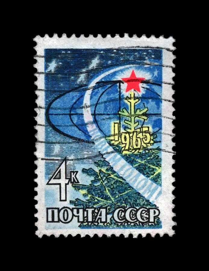 New Year Tree with bright red star, rocket orbit, USSR, circa 1964,. USSR - CIRCA 1964: canceled stamp printed in the USSR shows New Year Tree with bright red royalty free stock image