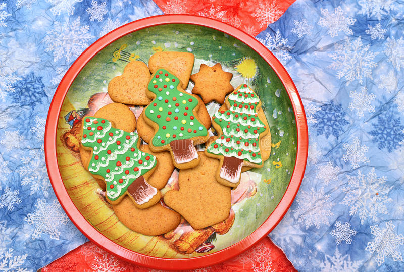 New year tree cookies on the dish. Horizontal. Flat. New year tree cookies. On the red and blue background. Free space royalty free stock images