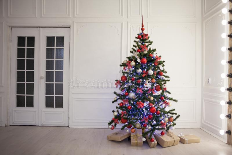 New year tree in the room with Christmas gifts royalty free stock image