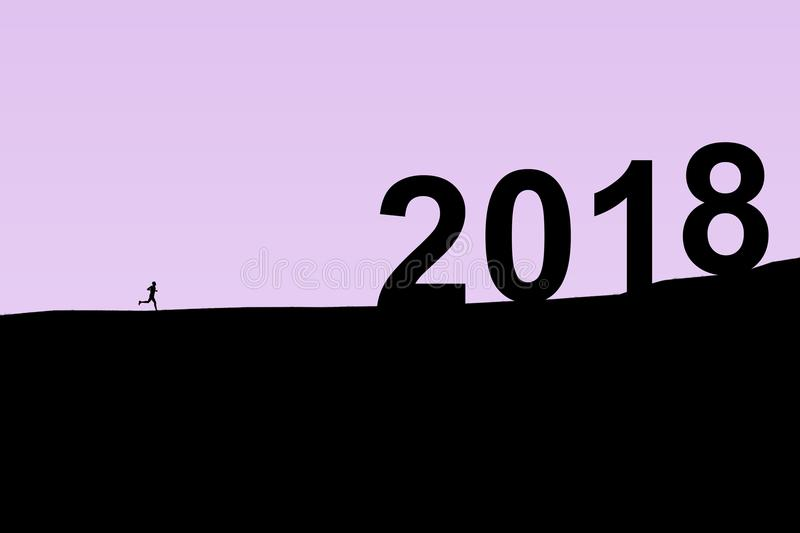 2018 New Year. Two thousand eighteen. Silhouette of the athlete running from foothills to the top of the mountain royalty free stock photography