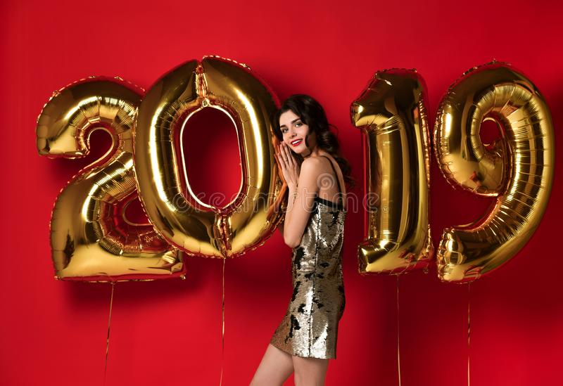 New Year. Woman With Balloons Celebrating At Party. stock photos