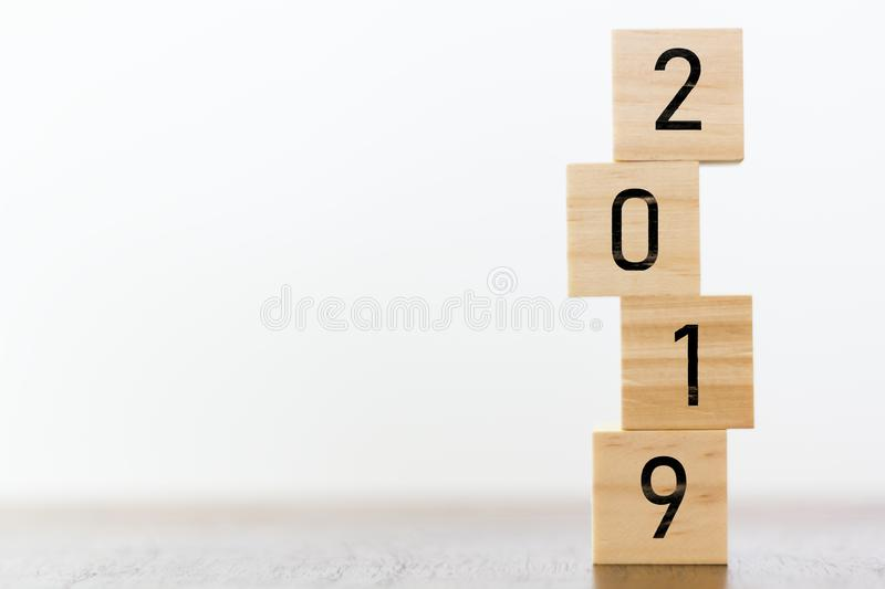 New year 2019 on wooden cubes on table with copy space for text royalty free stock images