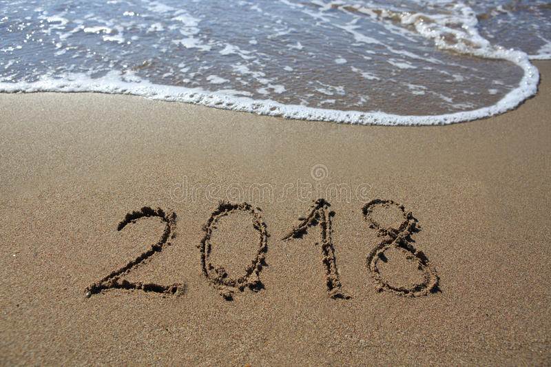 New year 2018 written in sand. stock image