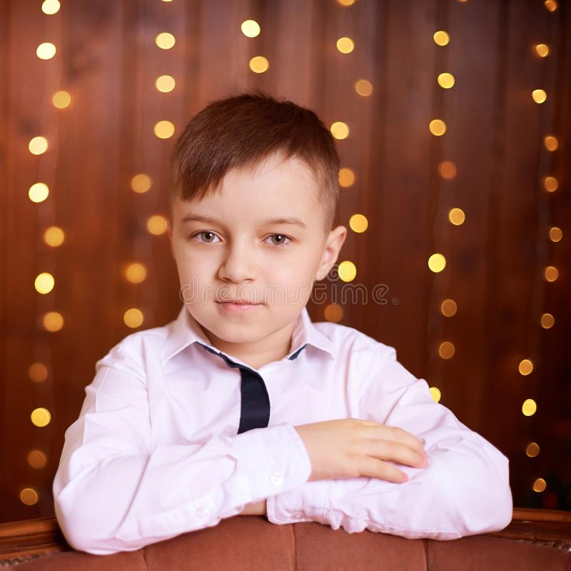 New Year xmas child. Christmas eve holiday. Beautiful portrait. Cute little boy. Brown background royalty free stock photo