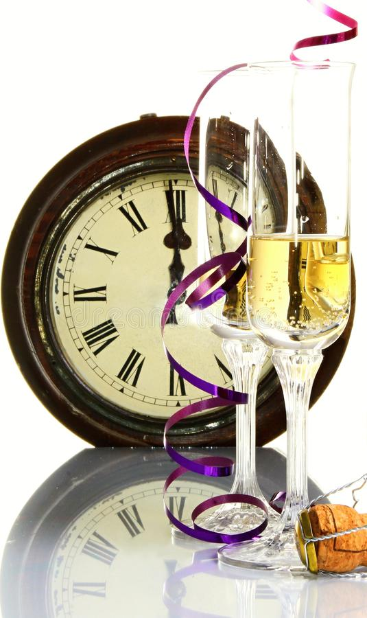 New years eve celebration with clock showing few minutes before midnight royalty free stock image