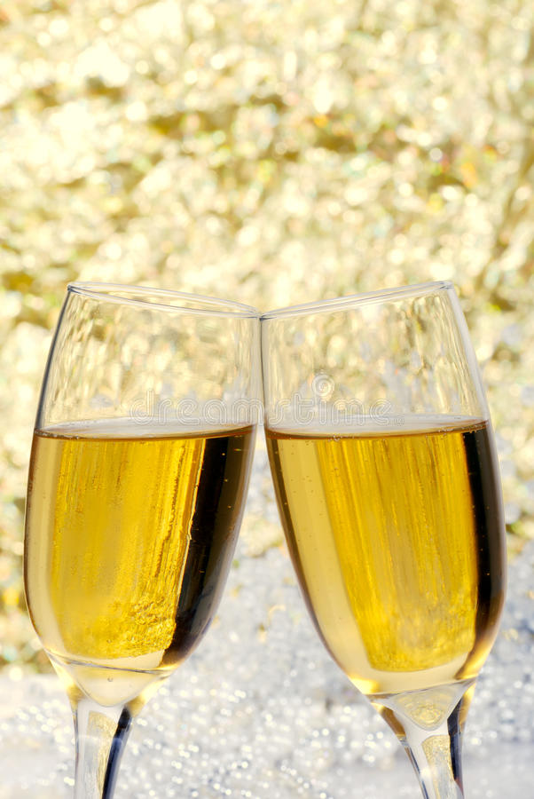 New years eve champagne toast. Closeup of new years eve champagne toast with two fluted glasses royalty free stock images