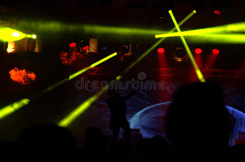 Lemon yellow laser beams of a concert scene royalty free stock image