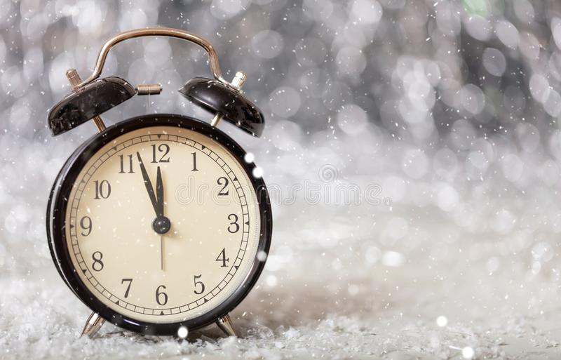 New Years eve countdown. Minutes to midnight on a vintage alarm clock. Copy space stock images