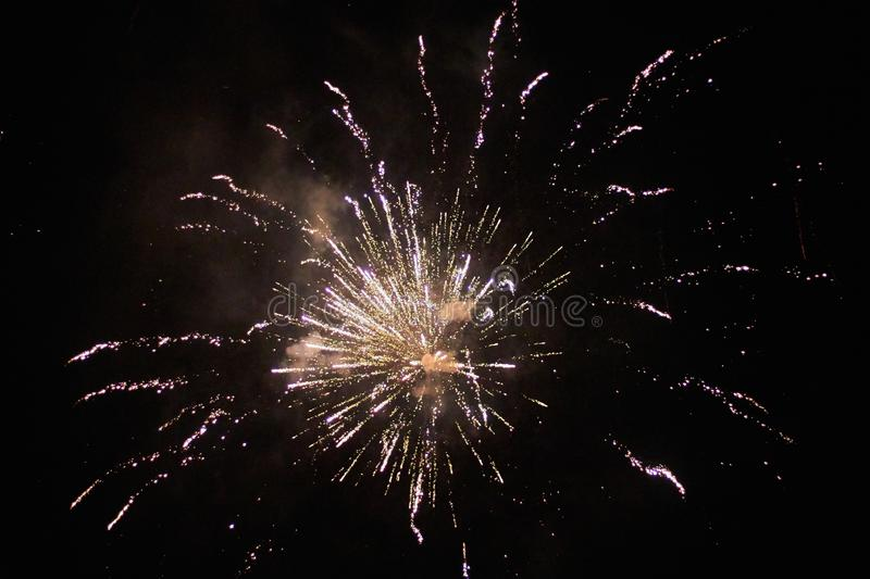 New Years Eve fireworks, several rockets exploding colourfullyin the beautiful night sky royalty free stock photography