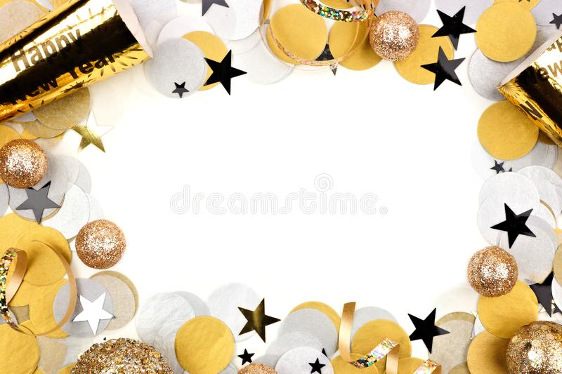 New Years Eve frame of confetti and decor isolated on white. New Years Eve frame of confetti and decor isolated on a white background royalty free stock photography