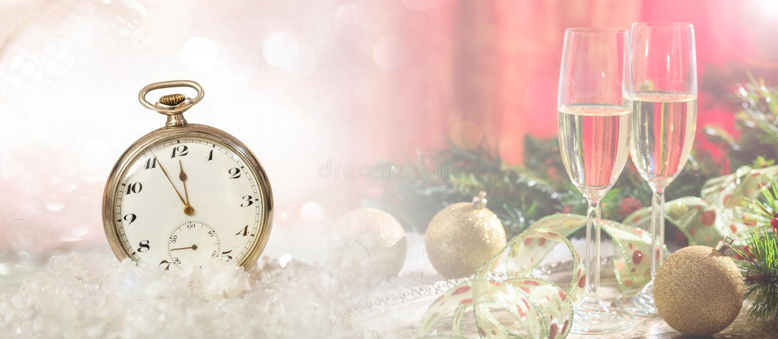 New Years eve party celebration. Minutes to midnight on an old fashioned watch, festive background. Banner stock photography