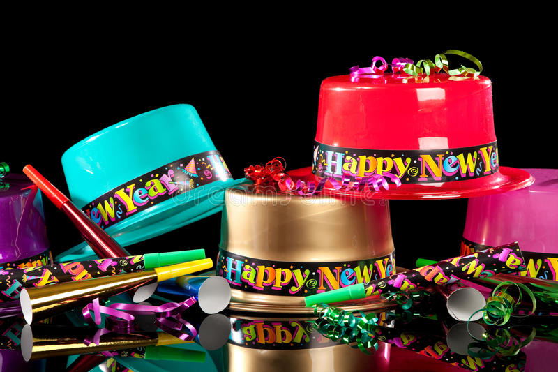 New Years' Eve party hats on black background stock photos