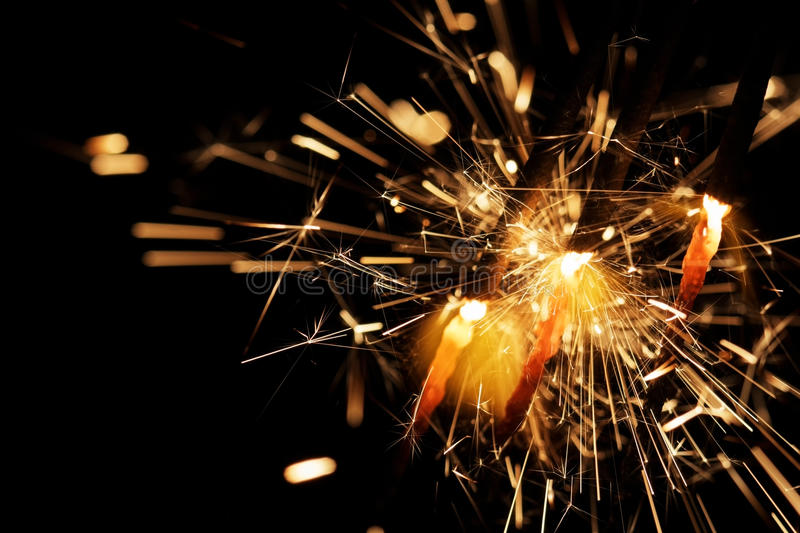 New Years eve sparkler on dark background royalty free stock photography