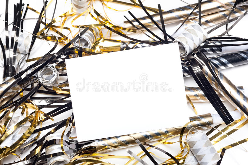 New Years party horns with blank invitation card stock image